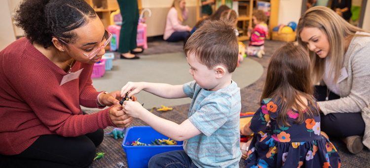 child and teacher engaged in imaginative play